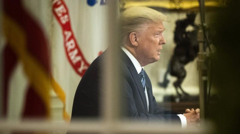 President Donald Trump speaks in an address to the nation from the Oval Office at the White House about the coronavirus. AP photo