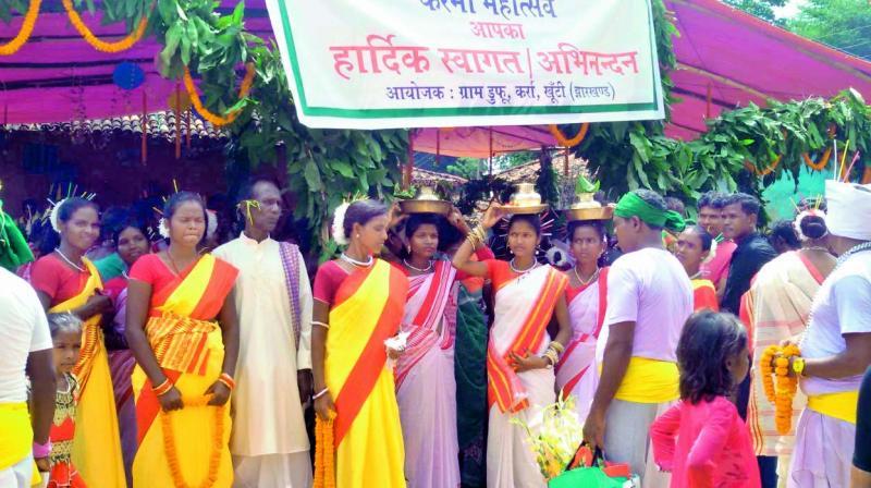 A group of tribal men and women from the Munda community at Karma Mahaustav in Jharkhand —Hercules Munda