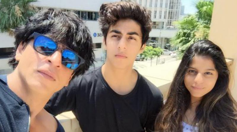 Shah Rukh Khan with Aryan and Suhana.
