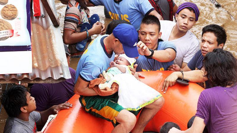 Nineteen deaths were reported near the town of Tubod on Friday on Mindanao, the archipelago nation's second-largest island, where Tropical Storm Tembin unleashed flash floods and mudslides erased a remote village from the map, police said. (Photo: AFP)