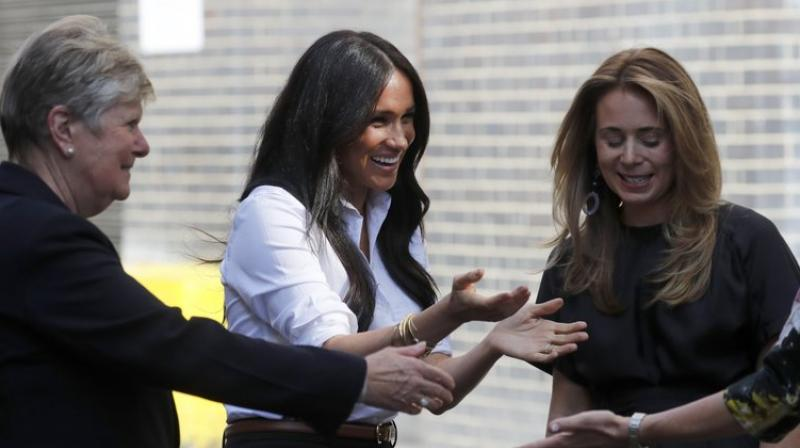 The line includes professional attire such as a blazer, tote bag and trousers. (Photo: AP)
