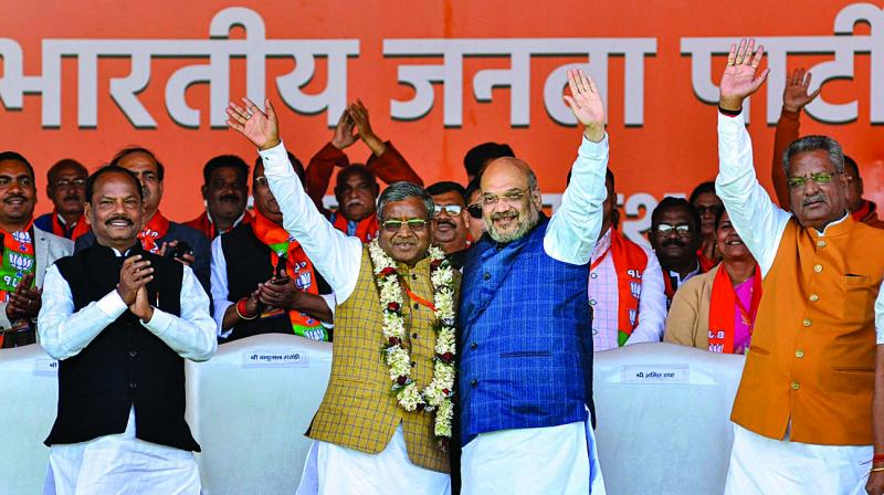 Union minister and senior BJP leader Amit Shah welcomes Jharkhand Vikas Morcha (JVM-Prajatantrik) chief Babulal Marandi after he merged his party with the BJP in Ranchi on Monday. (Photo: PTI)