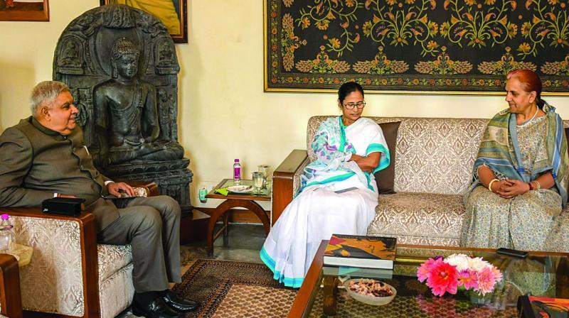 West Bengal chief minister Mamata Banerjee meets governor Jagdeep Dhankhar at the Raj Bhavan in Kolkata on Monday. (Photo: PTI)