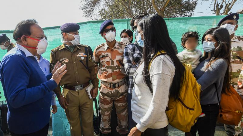 Union minister Harsh Vardhan interacts with Wuhan-returned Indians after they were released from the ITBP quarantine facility  in New Delhi on Monday. (Photo: PTI)