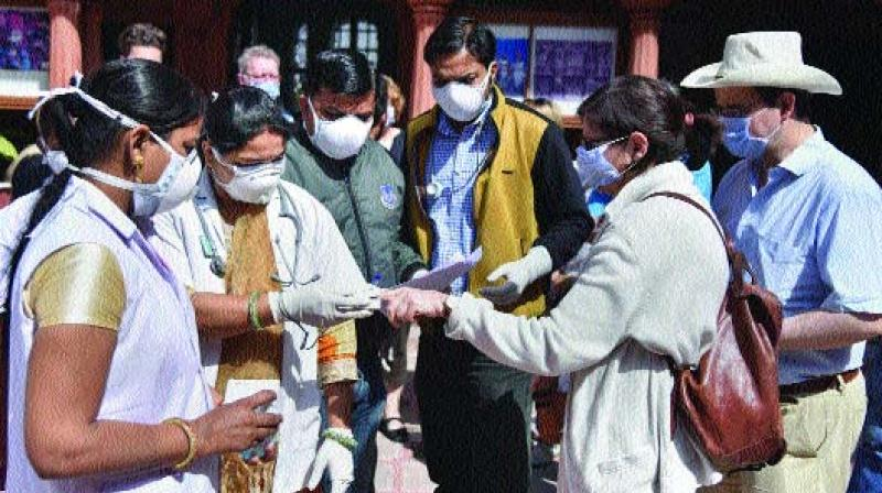 Medical officials check tourists in wake of the deadly coronavirus at Junagarh Fort in Bikaner on Friday. (Photo: PTI)