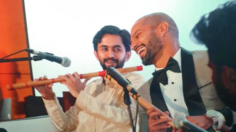 Shikhar Dhawan learns to play the flute