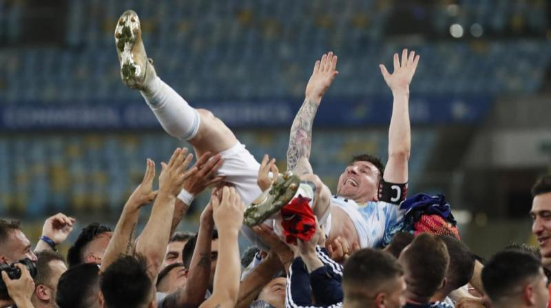 Teammates lift Argentina's Lionel Messi after beating Brazil 1-0 in the Copa America final soccer match at the Maracana stadium in Rio de Janeiro, Brazil. (Photo: AP)