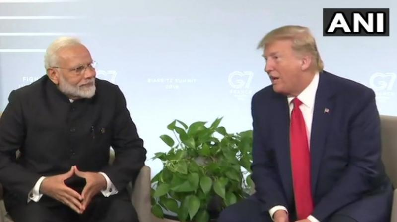 PM Modi with US President Donald Trump on the sidelines of G7 summit in France. (Photo: ANI)