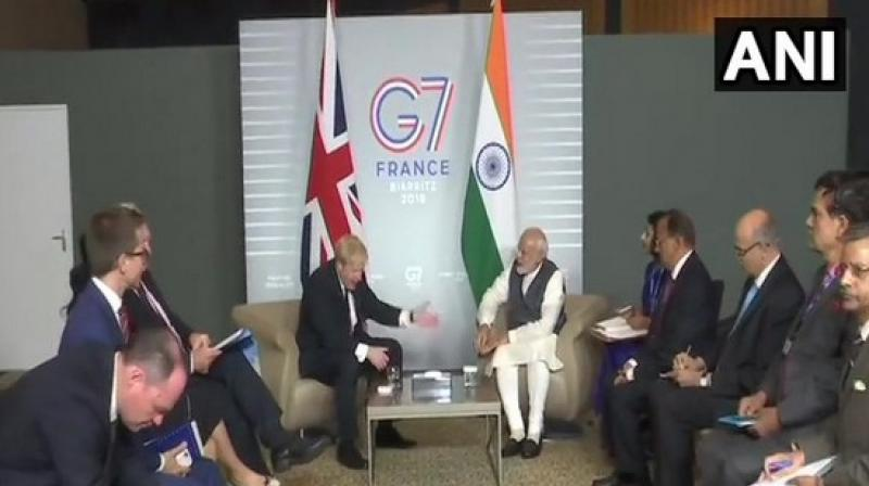 PM Narendra Modi with UK Prime Minister Boris Johnson. (Photo: ANI)
