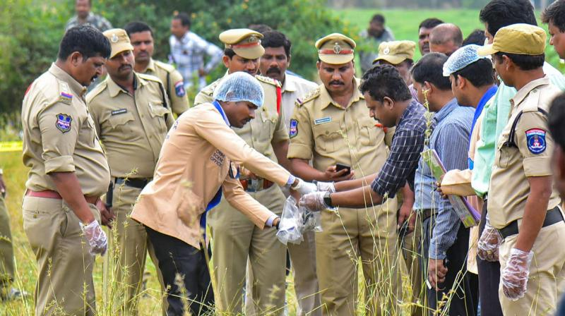 Forensic experts collect evidence from the spot where police shot dead four accused in the rape-and-murder case of a 25-year-old woman veterinarian. (Photo: PTI)