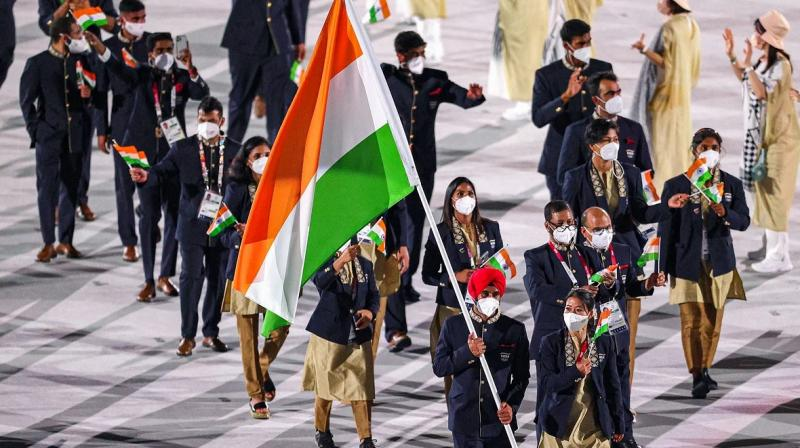 Flag bearers Boxer Mary Kom and Hockey player Manpreet Singh with other Indian athletes at the Oympic Stadium during the opening ceremony of the Summer Olympics 2020, in Tokyo. (Photo: PTI)