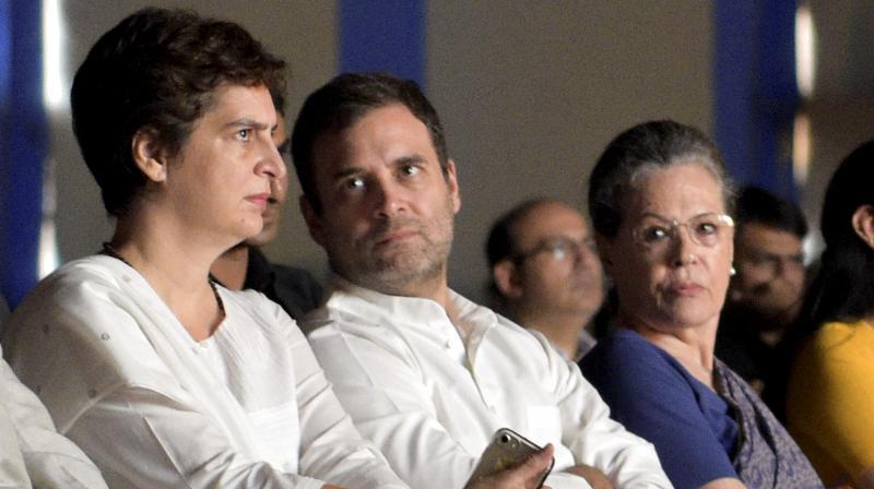 Congress leader Sonia Gandhi with Rahul Gandhi and Priyanka Gandhi (PTI File)