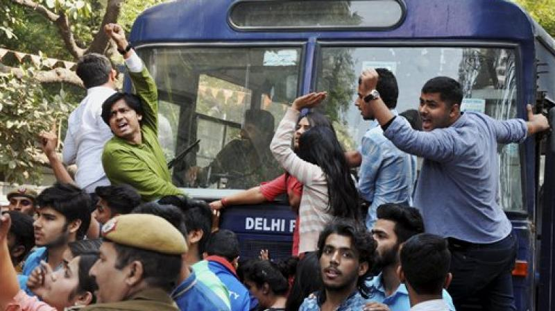 Clash between AISA and ABVP students over cancellation of JNU student Umar Khalid's talk at Ramjas College. (Photo: Twitter | ANI)