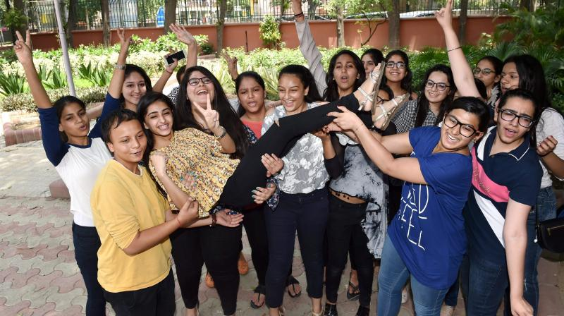 Students celebrate their success in CBSE class 12th examination at their school in New Delhi. (Photo: AP)