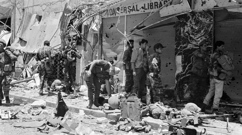 This file photo shows Israeli soldiers inspecting destruction in a street of Jerusalem during the Six-Day Arab-Israeli war. (Photo: AFP)