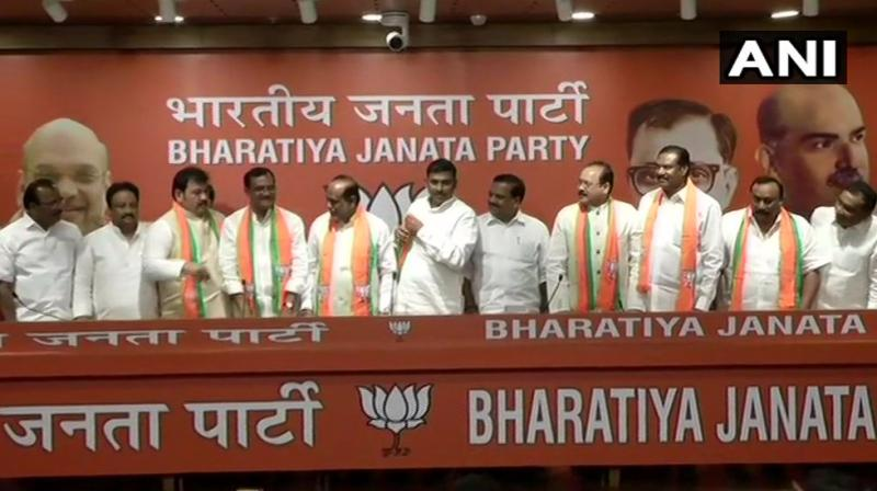 Former ministers in undivided Andhra Pradesh -- E Peddi Reddy and Boda Janardhan-- and former MP Suresh Reddy are some of the Telugu Desam Party (TDP) leaders who joined the BJP at its headquarters here. (Photo: ANI | Twitter)