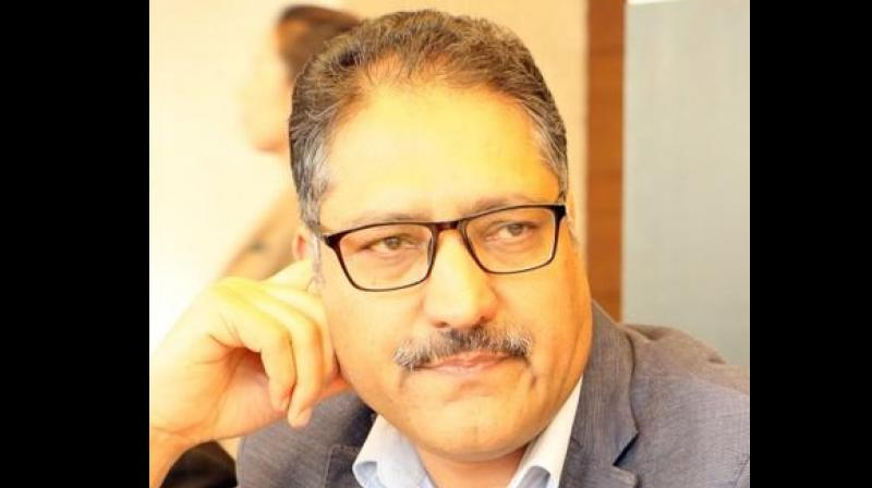 The condition of Shujaat Bukhari, editor of Rising Kashmir newspaper, remains critical. He was attacked by terrorists in Srinagar. (Twitter/ @bukharishujaat)