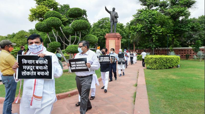 AAP MP Sanjay Singh and other opposition lawmakers march from Gandhi statue to Ambedkar statue in protest against the recent farm and labour bills, during the Monsoon Session, at Parliament House in New Delhi. — PTI photo