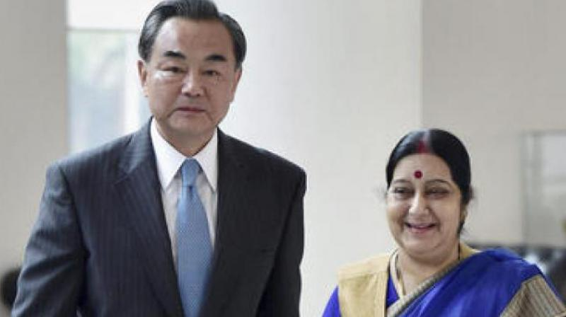 Chinese Foreign Minister Wang Yi with Indian External Affairs Minister Sushma Swaraj in New Delhi. (Photo: PTI)