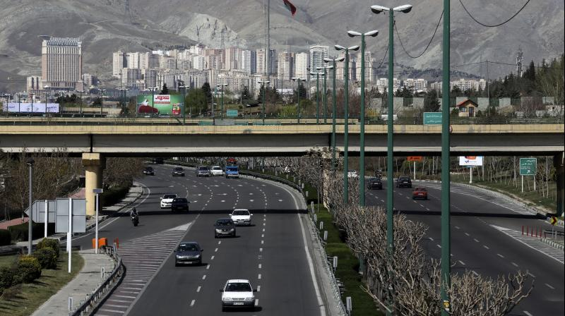 Cars drive in a highway in northern Tehran, Iran. AFP Photo
