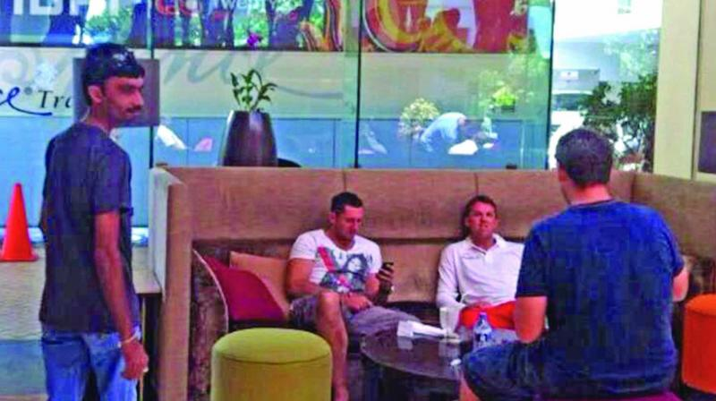 A screen grab from Al-Jazeera's sting operation shows alleged fixer Aneel Munawar (left) in a hotel lobby in Sri Lanka. Former England players Graeme Swann and Tim Bresnan are also seen.
