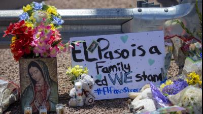 Flowers and a Virgin Mary painting adorn a makeshift memorial for the victims of Saturday mass shooting at a shopping complex in El Paso, Texas. (Photo: AP)