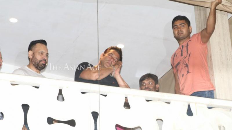 Salman Khan made a cute pose, where he meant that it's time to sleep and so, until next time. (Photo: Viral Bhayani)