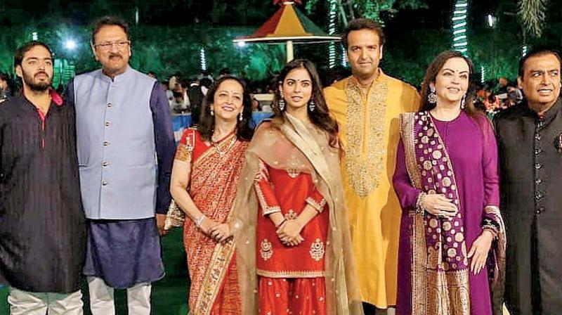 The Ambanis and Piramals pose together at the pre-wedding festivities.