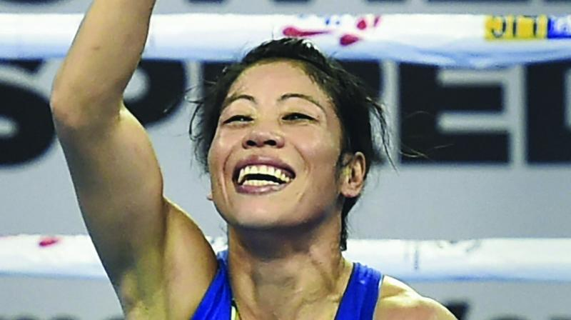 M. C. Mary Kom reacts after defeating China's Wu Yu in the quarterfinals of womens light flyweight (45-48 kg) category on Tuesday. (Photo: PTI)