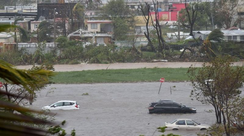 A parking lot is flooded near Roberto Clemente Coliseum in San Juan, Puerto Rico, following Hurricane Maria A parking lot is flooded near Roberto Clemente Coliseum in San Juan, Puerto Rico, following Hurricane Maria (Photo: AFP)
