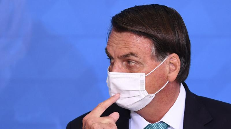 The deal to buy 20 million doses of Bharat Biotech's Covaxin shot has become a headache for Bolsonaro after whistleblowers went public with alleged irregularities. (AFP)