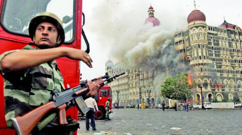 Armed forces personnel outside Taj, while the terrorists carry out the attack in the hotel. (Photo: File)