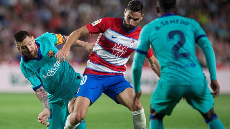 Barcelona threw on their stars of the present and the future but neither Lionel Messi nor Ansu Fati could save them from a dismal 2-0 defeat away at Granada. (Photo:AFP)