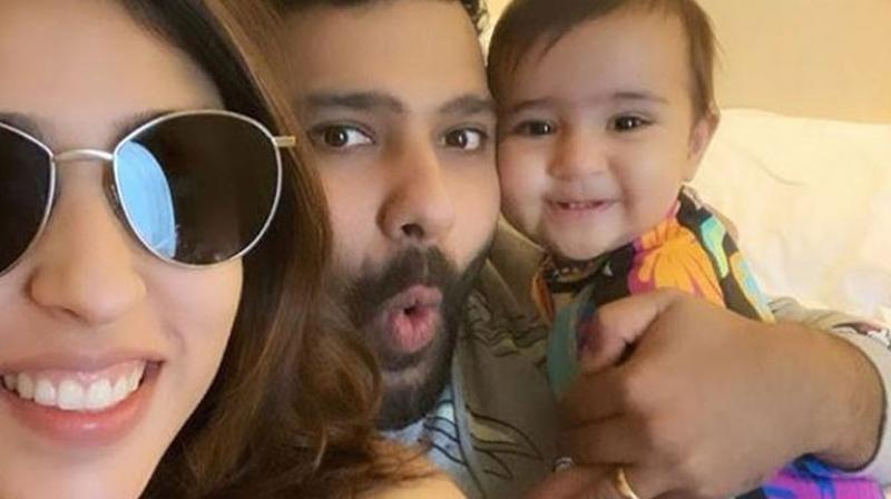 Recently, Indian spinner Yuzvendra Chahal got involved in a instagram banter with wife of 2019 World Cup's top scorer Rohit Sharma. Just a few days back, Rohit Sharma's wife Ritika Sajdeh uploaded a picture with her hubby and daughter Samaira with the caption 'Reunited'. (Photo: RitikaSajdeh/Instagram)