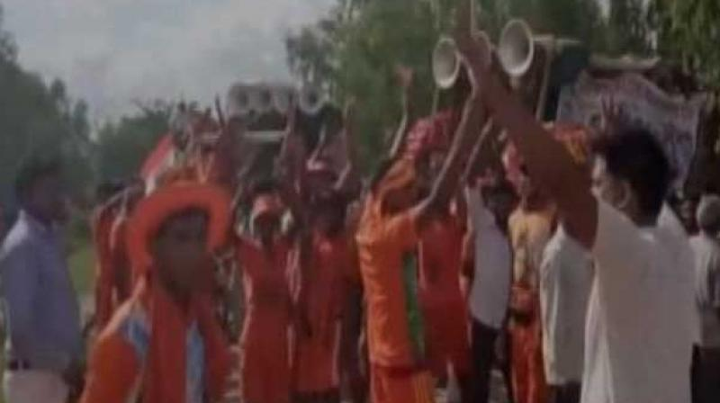 The group of devotees was going under the police security when some unknown people started pelting stones on them. (Photo: Twitter   ANI)