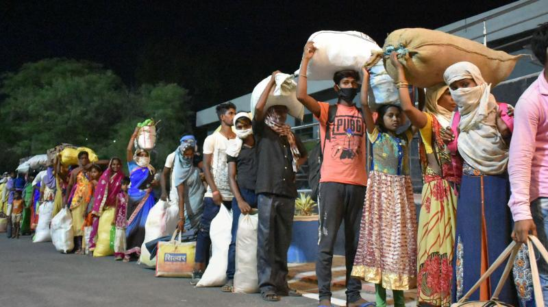 Migrants waiitng to leave Prayagraj on Monday. (PTI)
