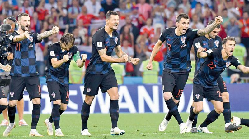 Croatian players celebrate after their penalty shootout victory in the quarter-final over Russia at the Fisht Stadium in Sochi on Saturday night. (Photo:  AFP)