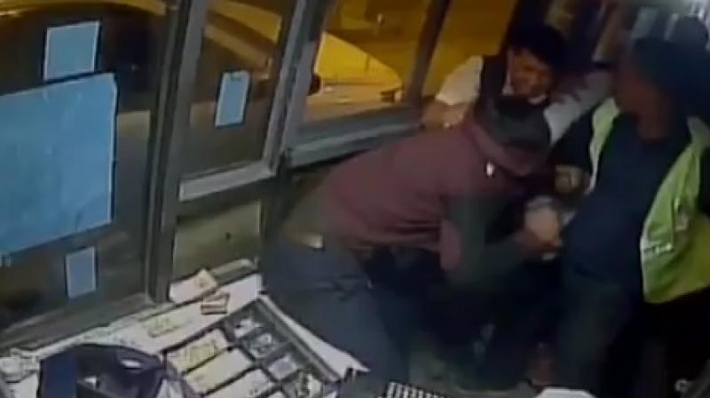 Yadav barged into the toll booth and started thrashing the victim. The booth was vandalized and all the things were thrown outside the booth. (Photo: Videograb)