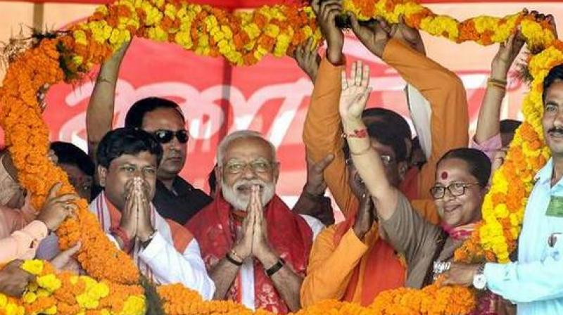 Prime Minister Narendra Modi at an election campaign rally in South Dinajpur district on Saturday. (Photo: PTI)