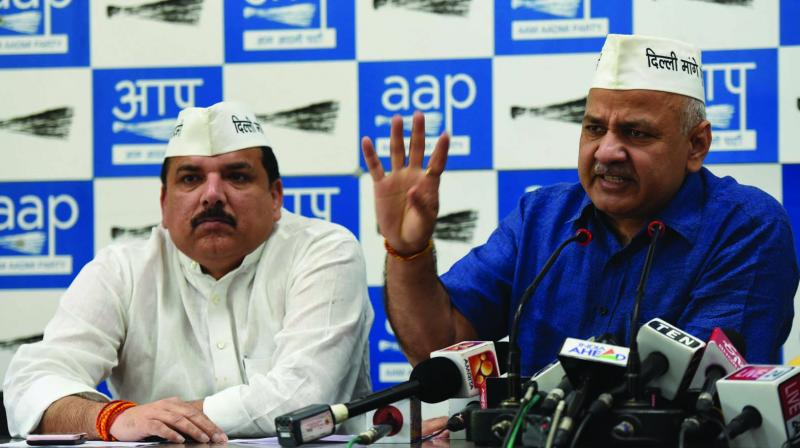 Deputy chief minister and senior AAP leader Manish Sisodia with party MP Sanjay Singh at a press meet in New Delhi on Saturday. (Photo: ASIAN AGE)