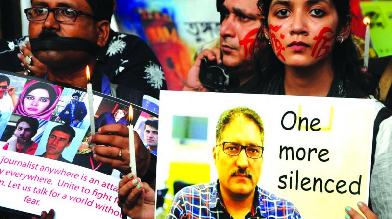 Mediapersons in a silent protest in front of Academy of Fine Arts on Friday, against the killing of journalist and editor Shujaat Bukhari in Kashmir and other media persons, those ware killed earlier. (Photo: Abhijit Mukherjee)