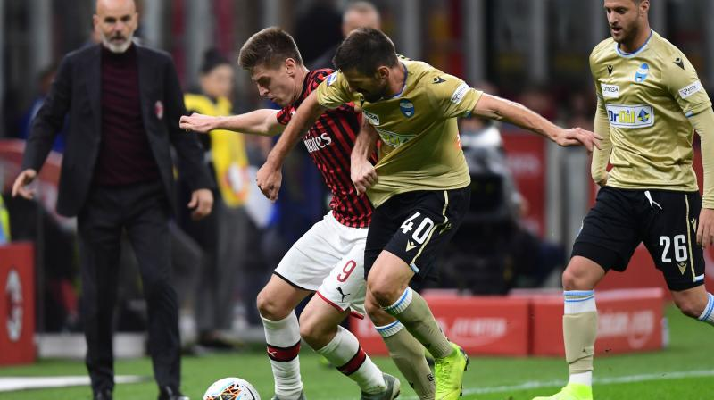 After a first half short on incident, winger Suso came off the bench in the 57th and scored six minutes later with a curling free kick into the top corner from the edge of the area after Krzysztof Piatek was brought down. (Photo:AFP)