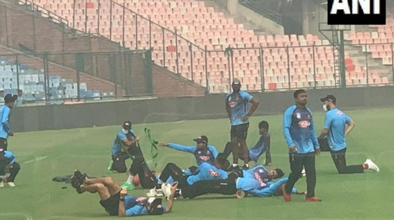 Bangladesh players Al Amin, Abu Hider Rony and team's spin consultant Daniel Vettori were seen wearing masks during their fielding session this morning. (Photo: ANI)