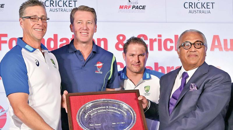 Troy Cooley (from left), Glenn McGrath, Ryan Harris and chairman and MRF CMD K.M. Mammen at an event.