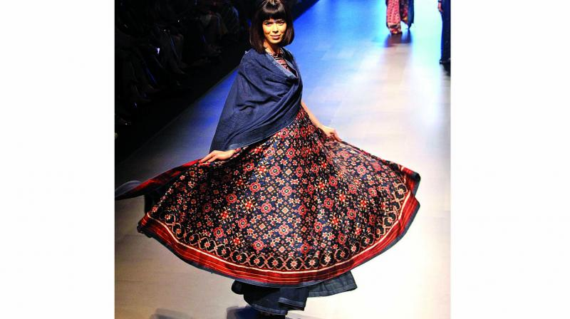 A dancer twirls onto the stage to the beats of the tabla.