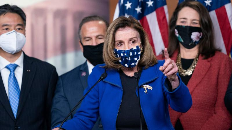 US Speaker of the House Nancy Pelosi, with House impeachment managers, speaks to the press after the Senate voted to acquit former US President Donald Trump, in the US Capitol in Washington, DC, on February 13, 2021. (Alex Edelman / AFP)