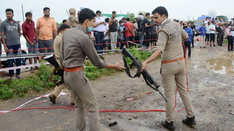Police inspect the encounter site where gangster Vikas Dubey was killed when he allegedly tried to escape from the spot following an accident, near Kanpur. PTI Photo