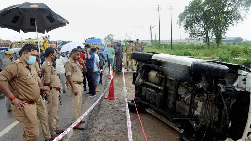 Police officers cordon the site where top criminal Vikas Dubey was killed near Kanpur. PTI Photo