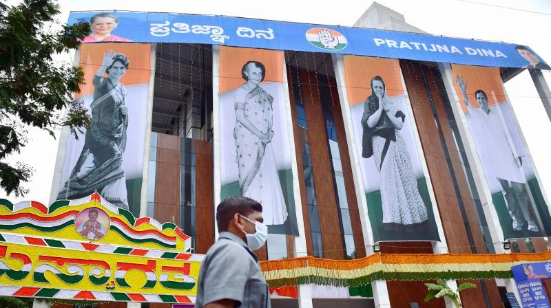 Posters of senior Congress leaders Sonia Gandhi, Indira Gandhi, Rahul Gandhi and Priyanka Gandhi Vadra on the newly built KPCC office during oath taking ceremony 'Pratigna Dina' of KPCC President, in Bengaluru. PTI Photo