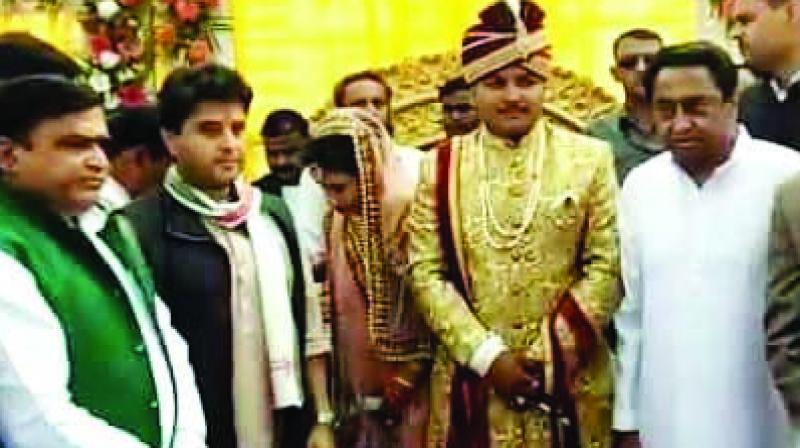 AICC general secretary Jyotiraditya Scindia and Madhya Pradesh chief minister Kamal Nath at a wedding ceremony.